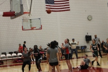 The girls and the female teachers were neck and neck the entire game.