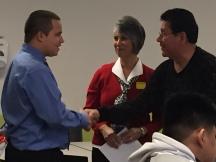 Senior Martin Munoz shook the hand of Cesar Chavez Scholarship Committee board member Joe Arce as he received the Cesar Chavez Scholarship.