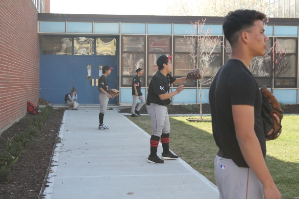The baseball team warms up before a game earlier this season.