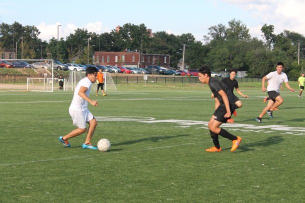 Junior Leonel Pina challenged AV alumnus Mauricio Cordero for the ball during the AV Alumni soccer game.